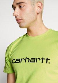 Carhartt WIP - SCRIPT - T-shirt imprimé - lime/black - 4