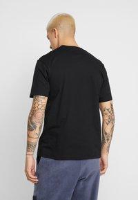 Carhartt WIP - MOTOWN POCKET  - Camiseta estampada - black/prism violet - 2