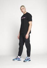 Carhartt WIP - SPORT SCRIPT - T-shirt med print - black - 1