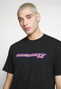 Carhartt WIP - SPORT SCRIPT - T-shirt med print - black - 3