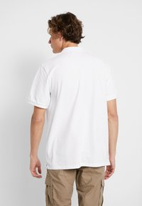 Carhartt WIP - CHASE - Polo - white/gold - 2