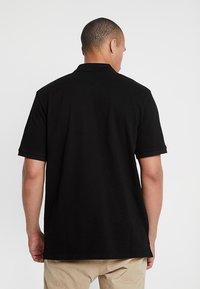 Carhartt WIP - CHASE - Poloshirt - black/gold - 2