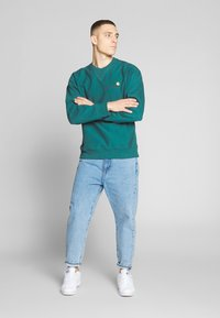 Carhartt WIP - AMERICAN SCRIPT - Sweatshirt - moody blue - 1