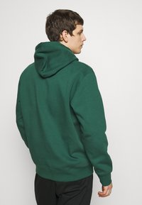 Carhartt WIP - HOODED DISTRICT - Luvtröja - dark green/yellow - 2