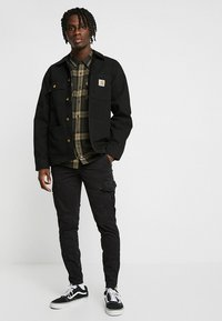 Carhartt WIP - MICHIGAN COAT DEARBORN - Lehká bunda - black rinsed - 1