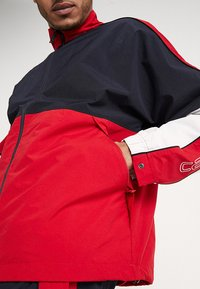 Carhartt WIP - Trainingsjacke - dark navy/cardinal/white - 5