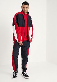 Carhartt WIP - Trainingsjacke - dark navy/cardinal/white - 1