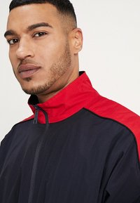 Carhartt WIP - Trainingsjacke - dark navy/cardinal/white - 3