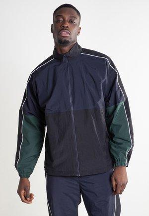 Training jacket - dark navy / black / bottle green