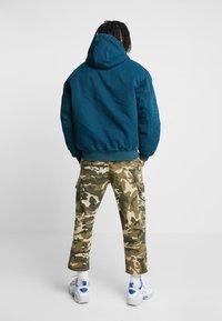 Carhartt WIP - ACTIVE JACKET DEARBORN - Lehká bunda - duck blue aged - 2