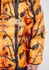 Carhartt WIP - JONES  - Winterjas - orange