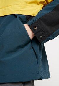 Carhartt WIP - BARNES  - Cortaviento - colza/duck blue/black - 5
