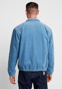 Carhartt WIP - MADISON JACKET - Lehká bunda - cold blue/dark navy rinsed - 2