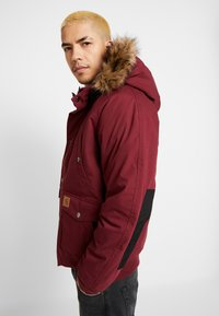 Carhartt WIP - TRAPPER JACKET - Parka - mulberry/black - 4