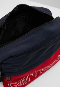 Carhartt WIP - TERRACE HIP BAG - Bum bag - cardinal/dark navy/white/ black - 4