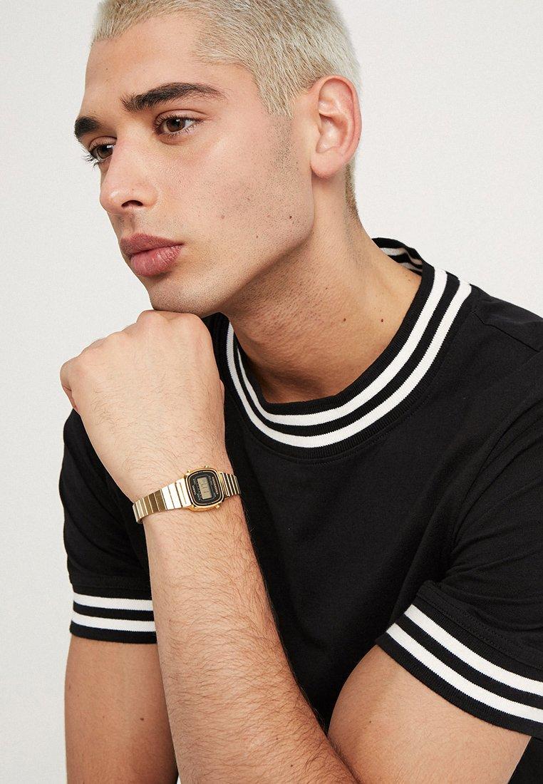 Casio - Digitaal horloge - gold-coloured/black