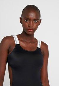 Calvin Klein Swimwear - LOGO OPEN CUT ONE PIECE - Maillot de bain - black - 3