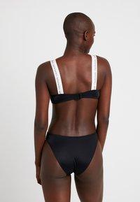 Calvin Klein Swimwear - LOGO OPEN CUT ONE PIECE - Maillot de bain - black - 2