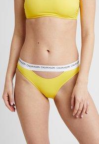 Calvin Klein Swimwear - CK LOGO CLASSIC - Bikini bottoms - habanero gold - 0