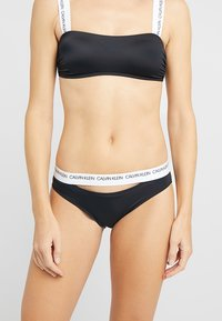 Calvin Klein Swimwear - CK LOGO CLASSIC - Spodní díl bikin - black - 0