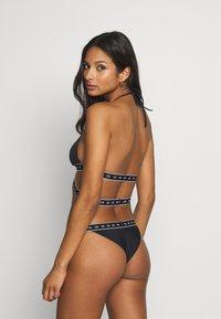 Calvin Klein Swimwear - CORE MONO TAPE BRAZILIAN - Bikini bottoms - black - 2