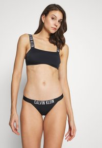 Calvin Klein Swimwear - INTENSE POWER BRAZILIAN - Spodní díl bikin - black - 1