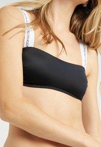 Calvin Klein Swimwear - LOGO BANDEAU - Bikinitop - black - 5