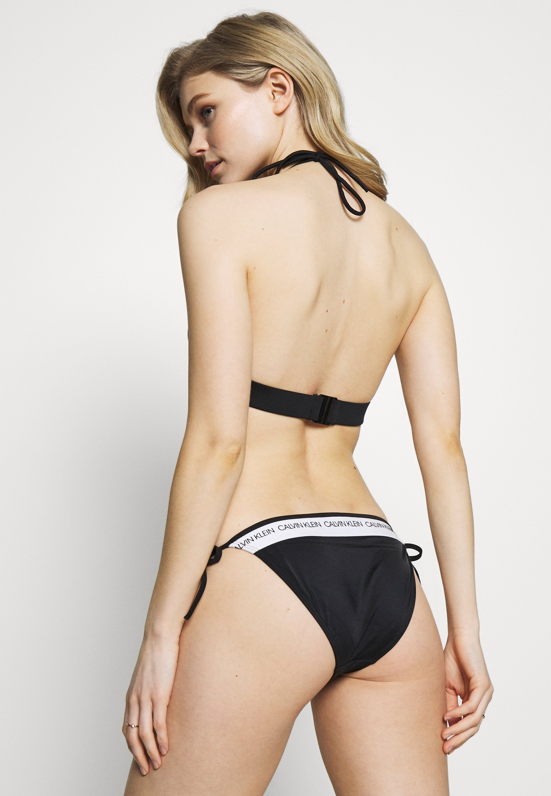 Calvin Klein Swimwear LOGO FIXED - Góra od bikini - black