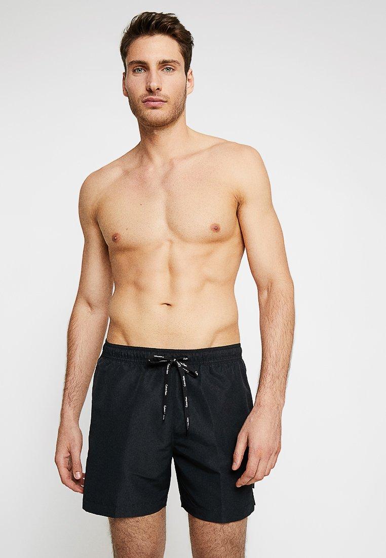 Calvin Klein Swimwear - MEDIUM DRAWSTRING - Shorts da mare - black