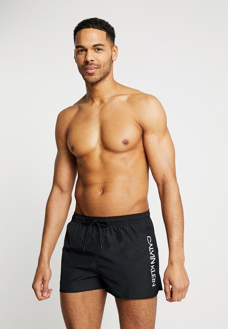 Calvin Klein Swimwear - SHORT RUNNER LOGO - Plavky - black