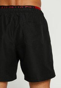 Calvin Klein Swimwear - MEDIUM DOUBLE WAISTBAND - Plavky - black - 1