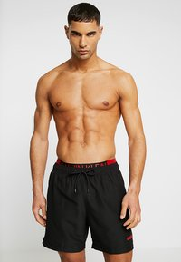 Calvin Klein Swimwear - MEDIUM DOUBLE WAISTBAND - Plavky - black - 0