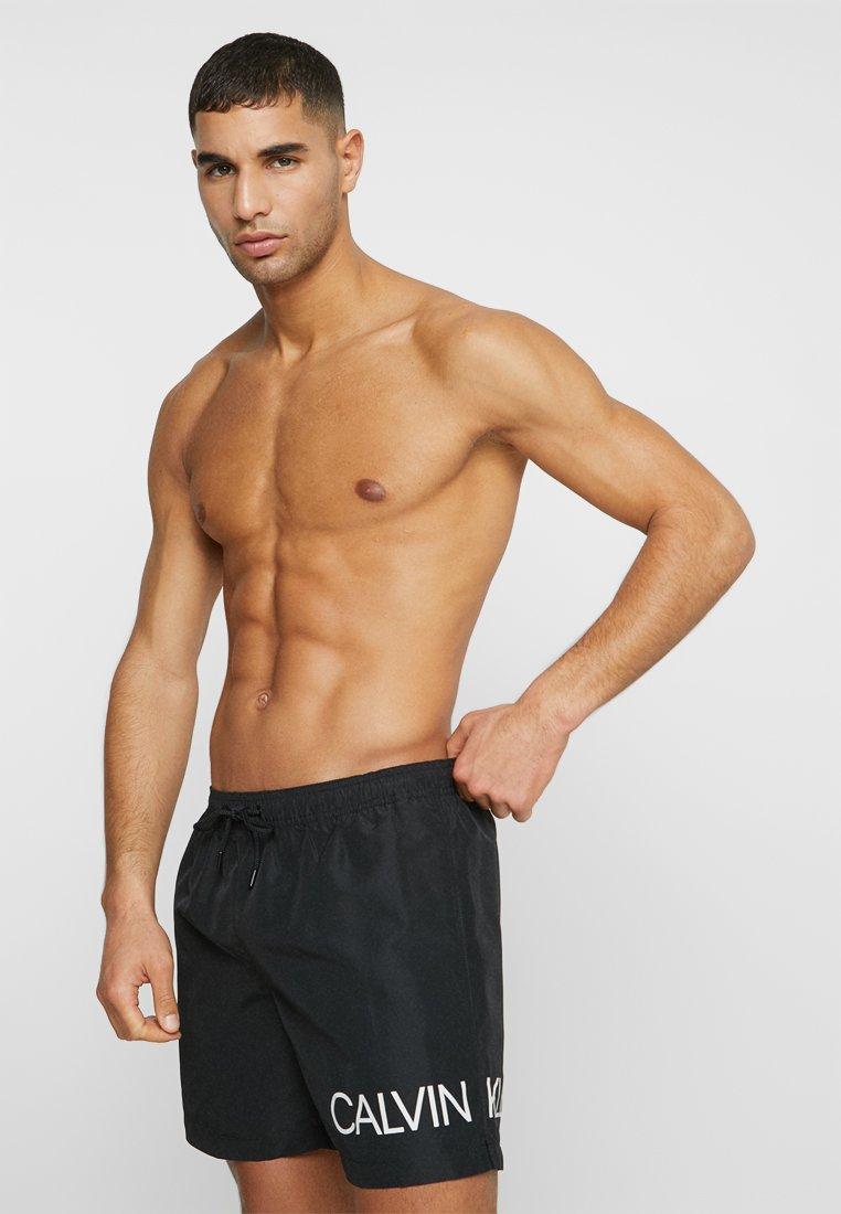 Calvin Klein Swimwear - MEDIUM DRAWSTRING SIDE - Swimming shorts - black