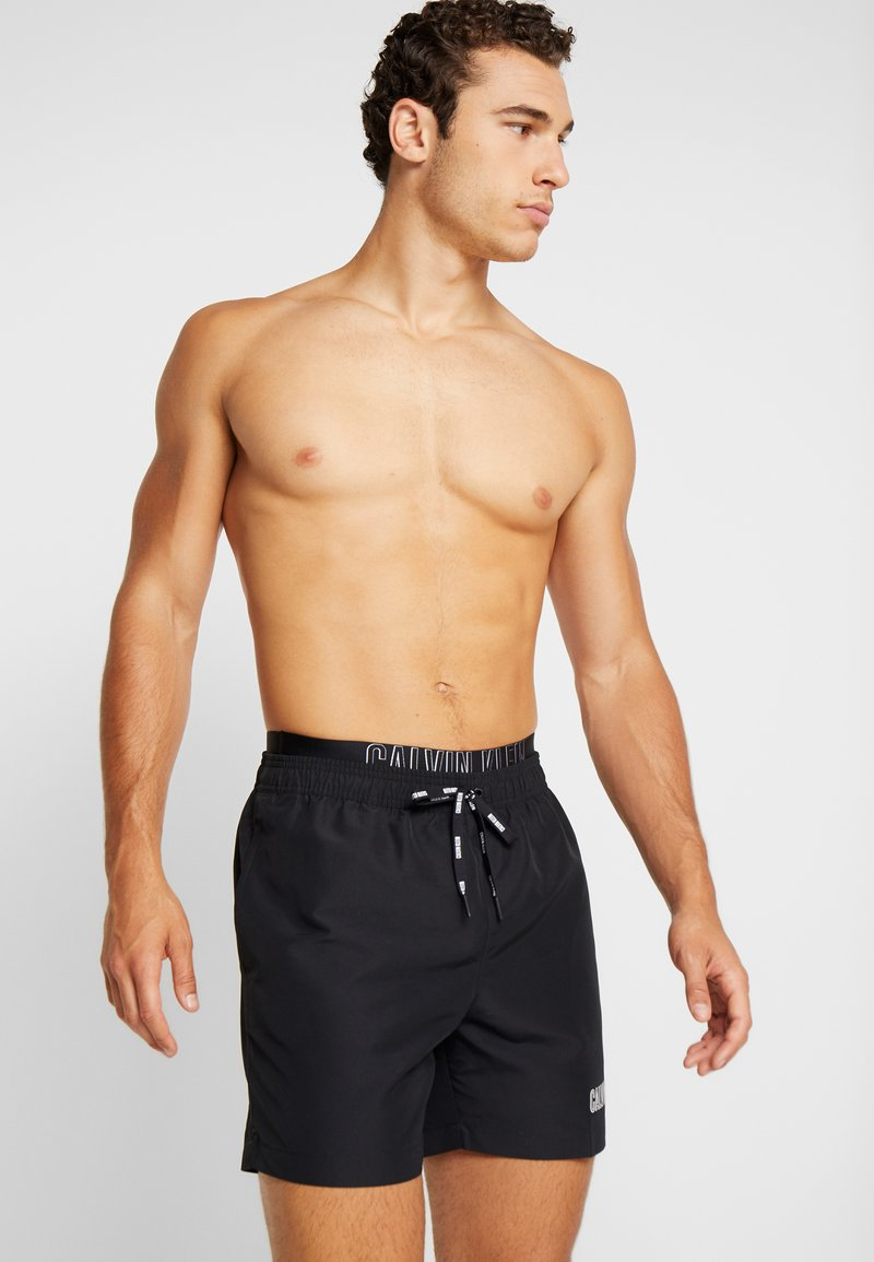 Calvin Klein Swimwear - MEDIUM DOUBLE WAISTBAND - Swimming shorts - black