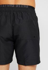 Calvin Klein Swimwear - MEDIUM DOUBLE WAISTBAND - Swimming shorts - black - 1