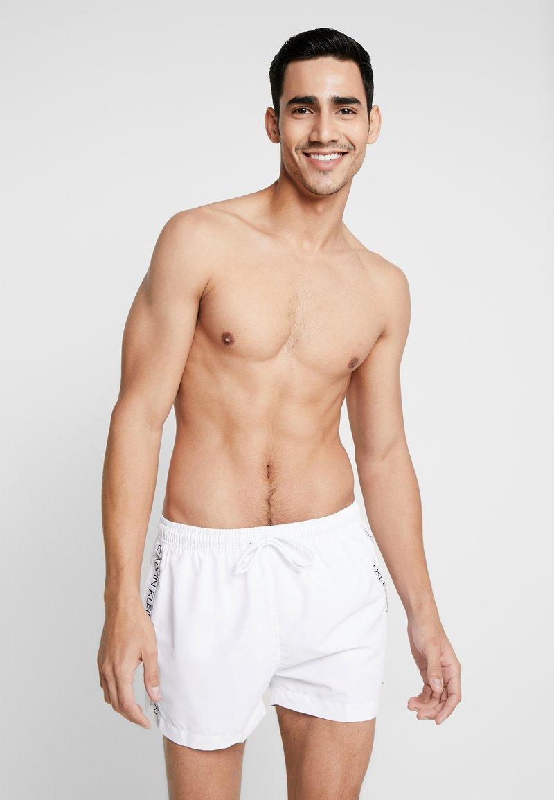 Calvin Klein Swimwear - DRAWSTRING - Swimming shorts - white