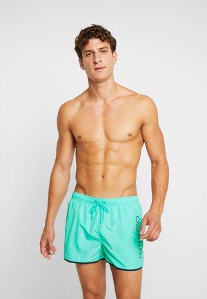 RUNNER - Swimming shorts - green
