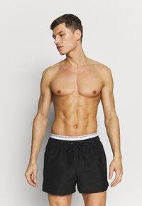Calvin Klein Swimwear - DOUBLE - Zwemshorts - black - 0