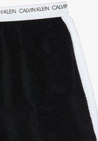 Calvin Klein Swimwear - SKIRT WAVE - Falda acampanada - black - 3