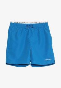 Calvin Klein Swimwear - MEDIUM DOUBLE WAISTBAND - Swimming shorts - imperial blue - 3