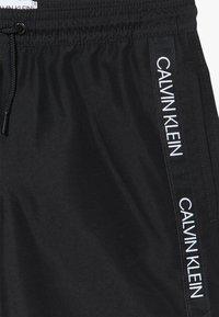 Calvin Klein Swimwear - MEDIUM DRAWSTRING LOGO - Plavky - black - 3