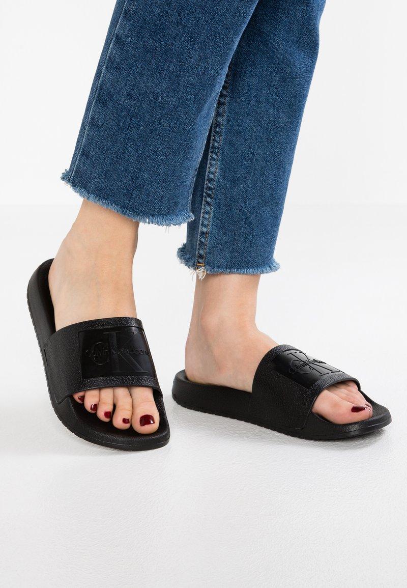 Calvin Klein Jeans - CHRISTIE - Sandały kąpielowe - black