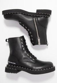 Calvin Klein Jeans - NANNIE - Snørestøvletter - black - 3