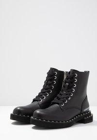 Calvin Klein Jeans - NANNIE - Snørestøvletter - black - 4