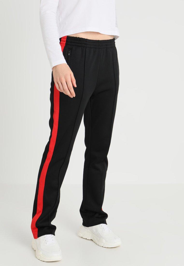 Calvin Klein Jeans - SIDE STRIPE TRACK PANT - Træningsbukser - black/racing red