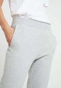 Calvin Klein Jeans - LOGO - Tracksuit bottoms - light grey/bright white - 3