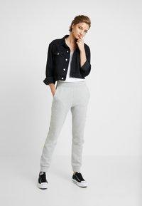 Calvin Klein Jeans - LOGO - Tracksuit bottoms - light grey/bright white - 1