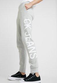 Calvin Klein Jeans - LOGO - Tracksuit bottoms - light grey/bright white - 6