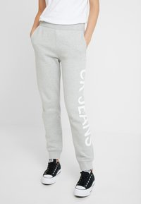 Calvin Klein Jeans - LOGO - Tracksuit bottoms - light grey/bright white - 0