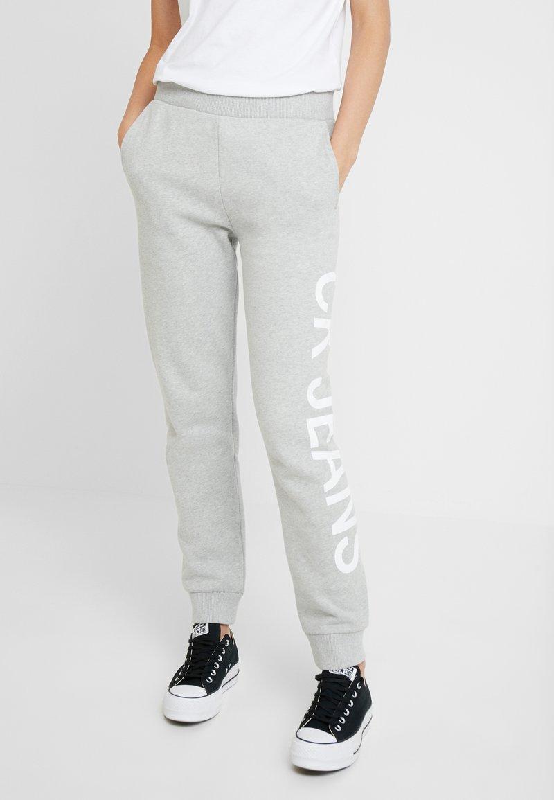 Calvin Klein Jeans - LOGO - Tracksuit bottoms - light grey/bright white